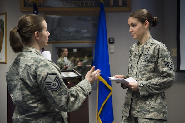 Staff Sgt. Jessica Thomas, 90th Missile Wing legal NCO in charge of military justice, answers additional questions after a Military Justice 101: Administrative Paperwork class at F.E. Warren Air Force Base, Wyo., April 5, 2017. More than 50 military members attended the class to discover the ins and outs of progressive discipline and writing effective administrative actions. (U.S. Air Force photo by Staff Sgt. Christopher Ruano)