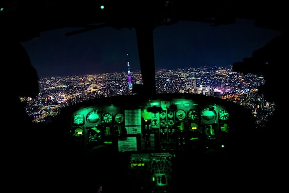 Aircrew fly towards Tokyo Tower during a 459th Airlift Squadron night hoist training exercise April 4, 2017, Tokyo, Japan. The training also included various landing and takeoff techniques throughout landing zones in the Tokyo metropolitan area. (U.S. Air Force photo by Airman 1st Class Donald Hudson)