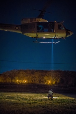 Capt. Lance M. Stafford, 36th Airlift Squadron pilot, a secures safety harness during a 459th Airlift Squadron night hoist training exercise April 4, 2017, Tokyo, Japan. The aircrew performed hoist insertion and extraction from 25-35 feet above ground. (U.S. Air Force photo by Airman 1st Class Donald Hudson)