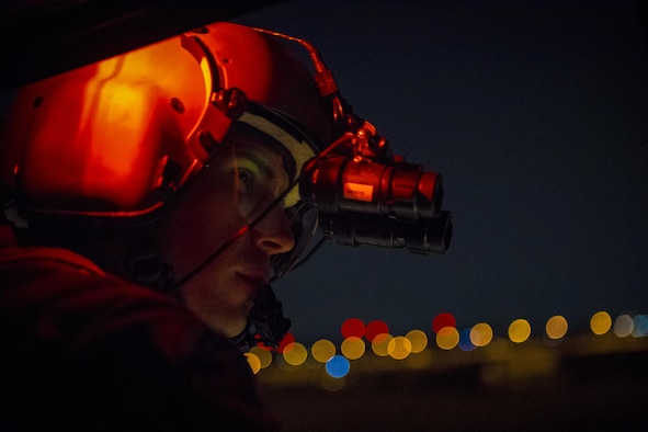 Staff Sgt. Nicholas A. Poe, 459th Airlift Squadron special mission's aviator, helps guide a UH-N1 Iroquois pilots to a landing point during a night hoist training exercise April 4, 2017, at Yokota Air Base, Japan. The training also included various landing and takeoff techniques throughout landing zones in the Tokyo metropolitan area. (U.S. Air Force photo by Airman 1st Class Donald Hudson)
