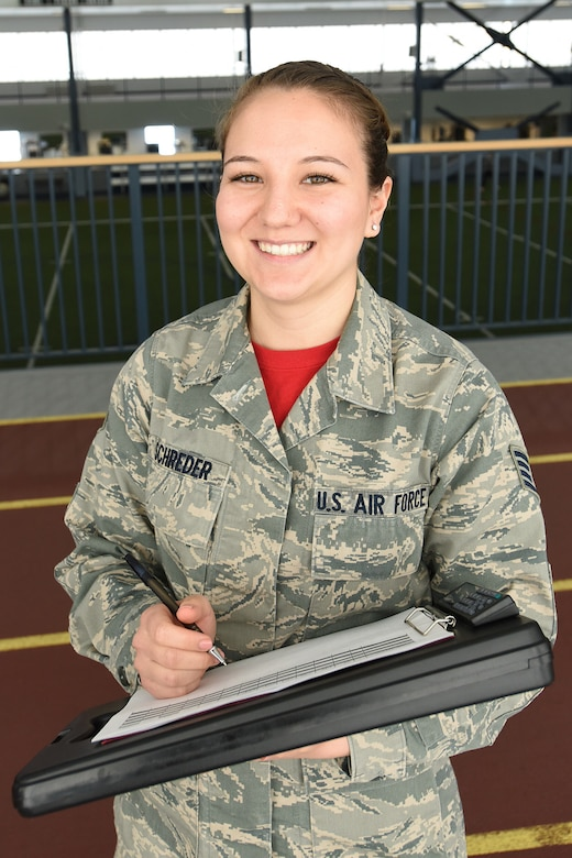 Air Force Staff Sgt. Megan Schreder, services craftsman for the Alaska Air National Guard's 168th Force Support Flight, administers fitness tests inside Baker Field House at Eielson Air Force Base, Alaska, April 2, 2017. Schreder, when not wearing Air Force camouflage, is a full-time elementary school teacher in Fairbanks, Alaska, and is in her second year of teaching. Air Force photo by Airman 1st Class Mae Olson