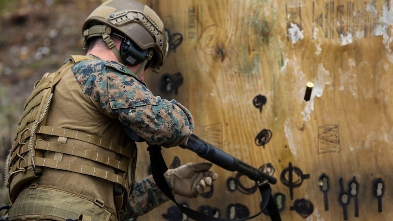 HM2 Spencer Eastman reloads a Mossberg 500 shotgun after shooting a round through a simulated door during a breaching exercise at Marine Corps Base Camp Lejeune, N.C., March 29, 2017. The Marines and sailors practiced techniques on how to successfully get through locked doors using shotguns and explosive charges. Eastman is a corpsman with 2nd Reconnaissance Battalion.
