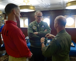 Deputy Defense Secretary Bob Work, center, speaks with Navy Rear Adm. William Byrne, left, commander of Carrier Strike Group 11, and Navy Rear Adm. Ross Myers, commander of Carrier Strike Group 15, during a visit to the aircraft carrier USS Nimitz at sea in the Pacific Ocean, April 4, 2017. Nimitz is underway conducting a composite training unit exercise with the Nimitz Carrier Strike Group in preparation for an upcoming deployment. Navy photo by Seaman Leon Wong