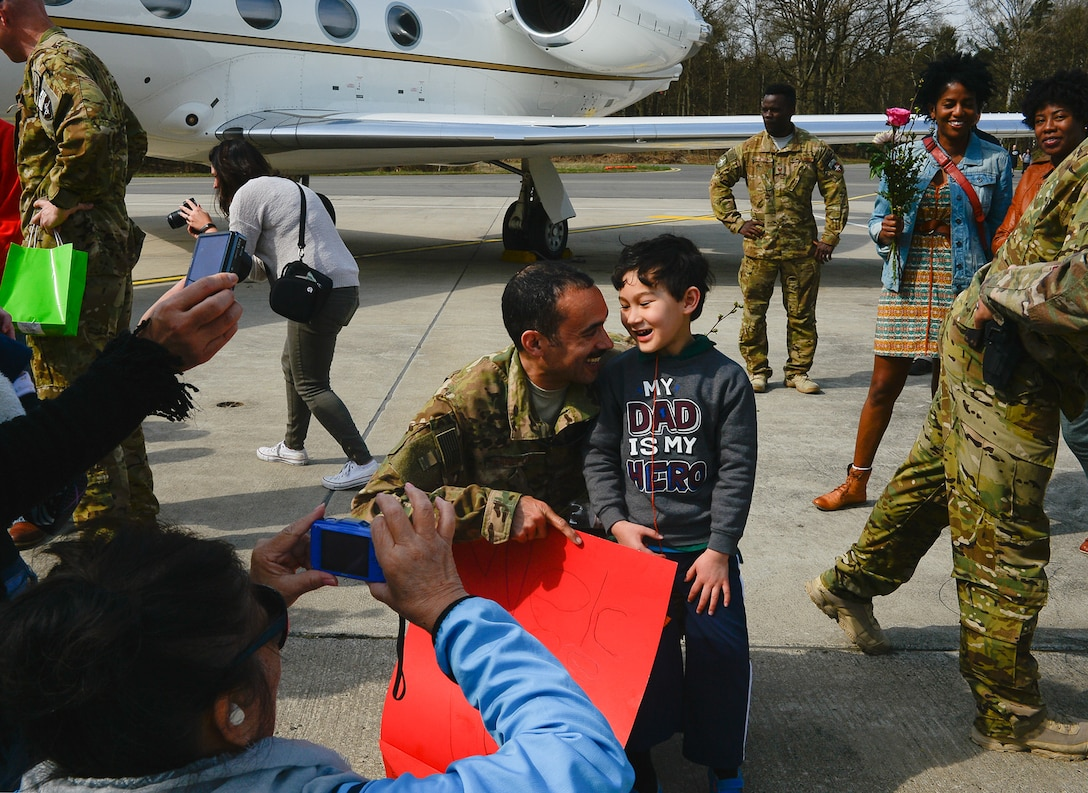 Maj. Anthony Langford, 76th Airlift Squadron pilot, poses for a photo with his son after returning from a deployment on Ramstein Air Base, Germany, April 1st, 2017. Consisting of more than 13,000 military service members, their mission directly impacted Operation Resolute Support, a NATO-led train, advise, and assist mission for the Afghan security forces. (U.S. Air Force photo by Airman 1st Class Joshua Magbanua)