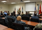 Army Brig. Gen. John Laskodi, DLA Distribution commanding general, interacts with the DLA Distribution San Joaquin, California, second shift employees during a town hall.
