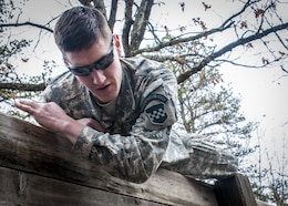 U.S. Army Sgt. Joshua D. Meyer climbs over a wall during the obstacle course portion of the 80th Training Command and 99th Regional Support Command's combined Best Warrior Competition April 5, 2017.