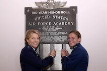 Lt. Gen. Michelle Johnson (left), the superintendent of the U.S. Air Force Academy, and now-2nd Lt.Rebecca Esselstein, the No. 1 graduate of the Academy's Class of 2015, pose for a photo  in front of the honor roll list in Fairchild Hall. Esselstein, a Rhodes scholar, competed in the four-mile-long UK Boat Race, stretching from Putney to Mortlake on the River Thames in South West London. (Air Force photo/Milke Kaplan)
