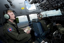 Capt. Kyle Wagner, left, a pilot for the 167th Airlfit Wing, calls out visual reference points during a low-level training sortie on a C-17 Globemaster III aircraft, April 4. Lt. Col. Joseph O'Rourke, right, active duty advisor pilot for the 167th Airlift Squadron, provided instruction during the training flight which inlcuded touch-and-go and aerial refueling practice. (U.S. Air National Guard photo by Senior Master Sgt. Emily Beightol-Deyerle)