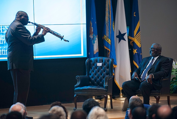 """Wynueco Washington, a DLA Land and Maritime associate, surprised Lewis with a special performance of """"Georgia on my Mind,"""" a tribute to Lewis' hometown, during a March 31 retirement ceremony."""
