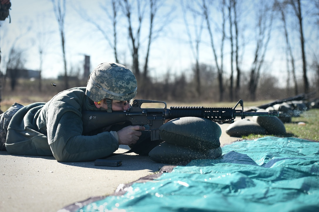 Army Reserve Staff Sgt. David Kukla, operations sergeant assigned to the 85th Support Command headquarters, qualifies with an M-16 rifle during a unit individual marksmanship qualification, Apr. 1, 2017. Kukla is and Engagement Skills Trainer 2000 instructor for the command. The EST-2000 is a state-of-the-art marksmanship simulator that enhances Soldier qualification performance ahead of live-fire qualifications. Kukla qualified hitting 38 out of 40 targets. 100 percent of the command's headquarters staff qualifying on the M-16 achieved success.