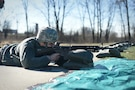 Army Reserve Staff Sgt. David Kukla, operations sergeant assigned to the 85th Support Command headquarters, qualifies with an M-16 rifle during a unit individual marksmanship qualification, Apr. 1, 2017. Kukla is and Engagement Skills Trainer 2000 instructor for the command. The EST-2000 is a state-of-the-art marksmanship simulator that enhances Soldier qualification performance ahead of live-fire qualifications. Kukla qualified hitting 38 out of 40 targets. 100 percent of the command's headquarters staff qualifying on the M-16 achieved success. (U.S. Army Reserve photo by Sgt. Aaron Berogan)