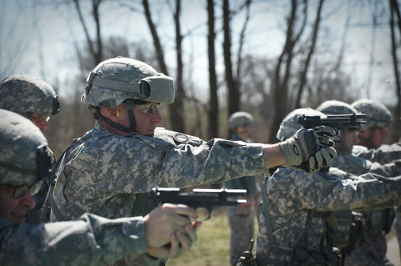 Col. Robert Cooley, Deputy Commander, 85th Support Command, engages his targets on the M9 qualification range during the headquarters individual weapons qualification at Joliet Training Area, Apr. 1, 2017. The headquarters staff spent one battle assembly day at the range to qualify on the M16 rifle and M9 pistol achieving a 100 percent qualification rate on the M-16 and an 88 percent qualification rate on the M9. (U.S. Army Reserve photo by Sgt. Aaron Berogan)