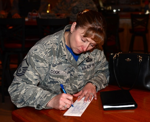 Master Sgt. Jennifer Cook, manpower office superintendent assigned to the 28th Force Support Squadron, donates to the Air Force Assistance Fund in the Dakota's Cub at Ellsworth Air Force Base, S.D., March 31, 2017. The AFAF is an annual effort to raise funds for charitable affiliates that provide support to Air Force families in need including active duty, retirees, reservists, guard and dependents. (U.S. Air Force photo by Airman 1st Class Donald C. Knechtel)