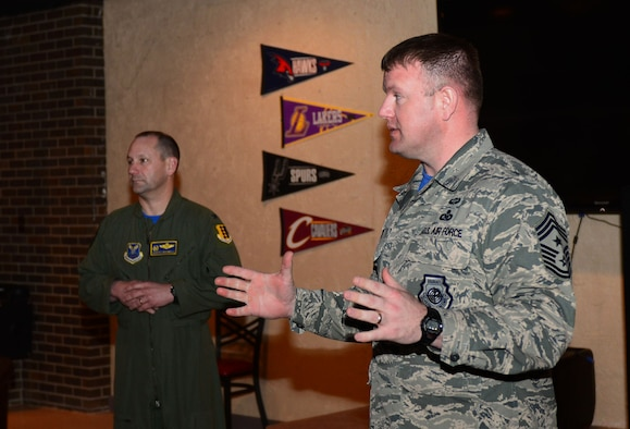 Col. Gentry Boswell, 28th Bomb Wing commander, and Chief Master Sgt. Adam Vizi, 28th Bomb Wing command chief, speak on the importance of the Air Force Assistance Fund inside the Dakota's Cub at Ellsworth Air Force Base, S.D., March 31, 2017. If interested in donating contact a unit AFAF representative. For more information on the different charities, call (800) 258-1413 for Air Force Enlisted Village, (800) 554-5510 for the General and Mrs. Curtis E. LeMay Foundation, (800) 655-3083 for Air Force Villages Indigent Widows' Fund, and (703) 972-2650 for Air Force Aid Society. (U.S. Air Force photo by Airman 1st Class Donald C. Knechtel)