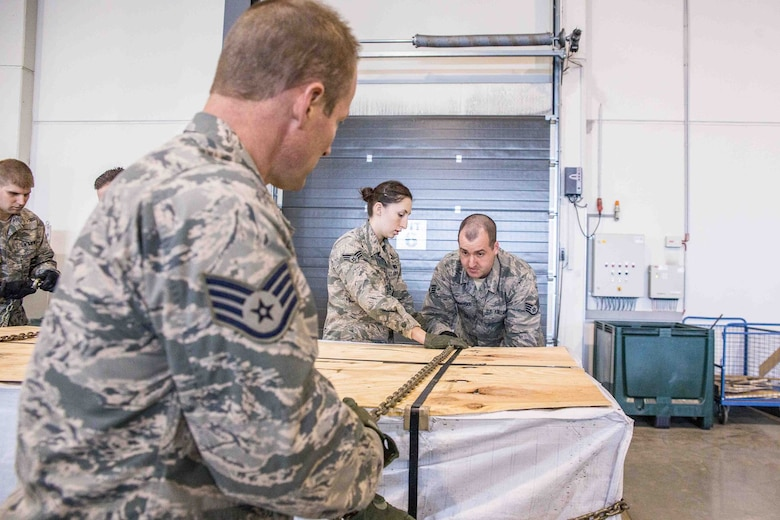 U.S. Airmen assigned to the 139th Logistics Readiness Squadron, Missouri Air National Guard, are trained on how to use a chain gate to secure heavy loads, during deployment field training at Ramstein Air Base, Germany, April 5, 2016. Over 40 Airmen with 139 LRS were working alongside their counterparts from the 86th Airlift Wing to enhance their skill levels within their individual career fields. Ramstein Air Base supports three theaters: United States Africa Command, Central Command, and European Command. (U.S. Air National Guard photo by Staff Sgt. Patrick P. Evenson)