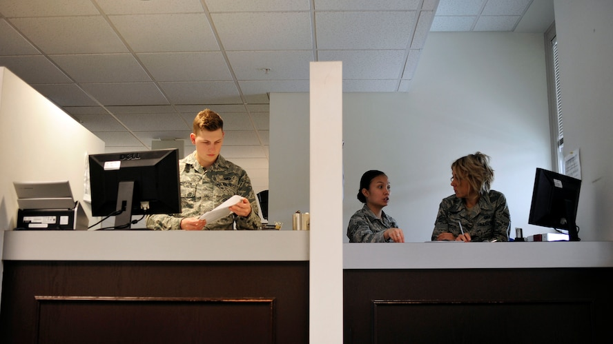 Airman 1st Class James Lenington (left), 62nd Comptroller Squadron financial services technician, Airman 1st Class Joyce Stewart (center), 62nd CPTS financial services technician, and Airman 1st Class Kelly McPherson (right), 62nd CPTS financial services technician, perform training and administrative tasks while waiting for customers to arrive at the finance office, April 4, 2017 at McChord Field, Wash. Financial technicians are available to help with military pay, travel pay to include permanent change of station and temporary duty, LeaveWeb, and civilian pay and disbursing. (U.S. Air Force photo/Staff Sgt. Whitney Amstutz)