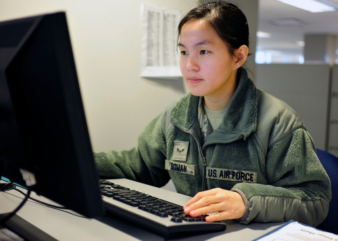 Airman 1st Class Vien Roman, 62nd Comptroller Squadron financial services technician, inputs information at the finance customer service desk, April 5, 2017 at McChord Field, Wash. Open from 9 a.m. to 3 p.m. Monday, Wednesday and Friday, and 7:30 a.m. to 3 p.m. Tuesday and Thursday, financial technicians assist Airmen one-on-one to ensure mutual understanding and expeditious support. (U.S. Air Force photo/Staff Sgt. Whitney Amstutz)