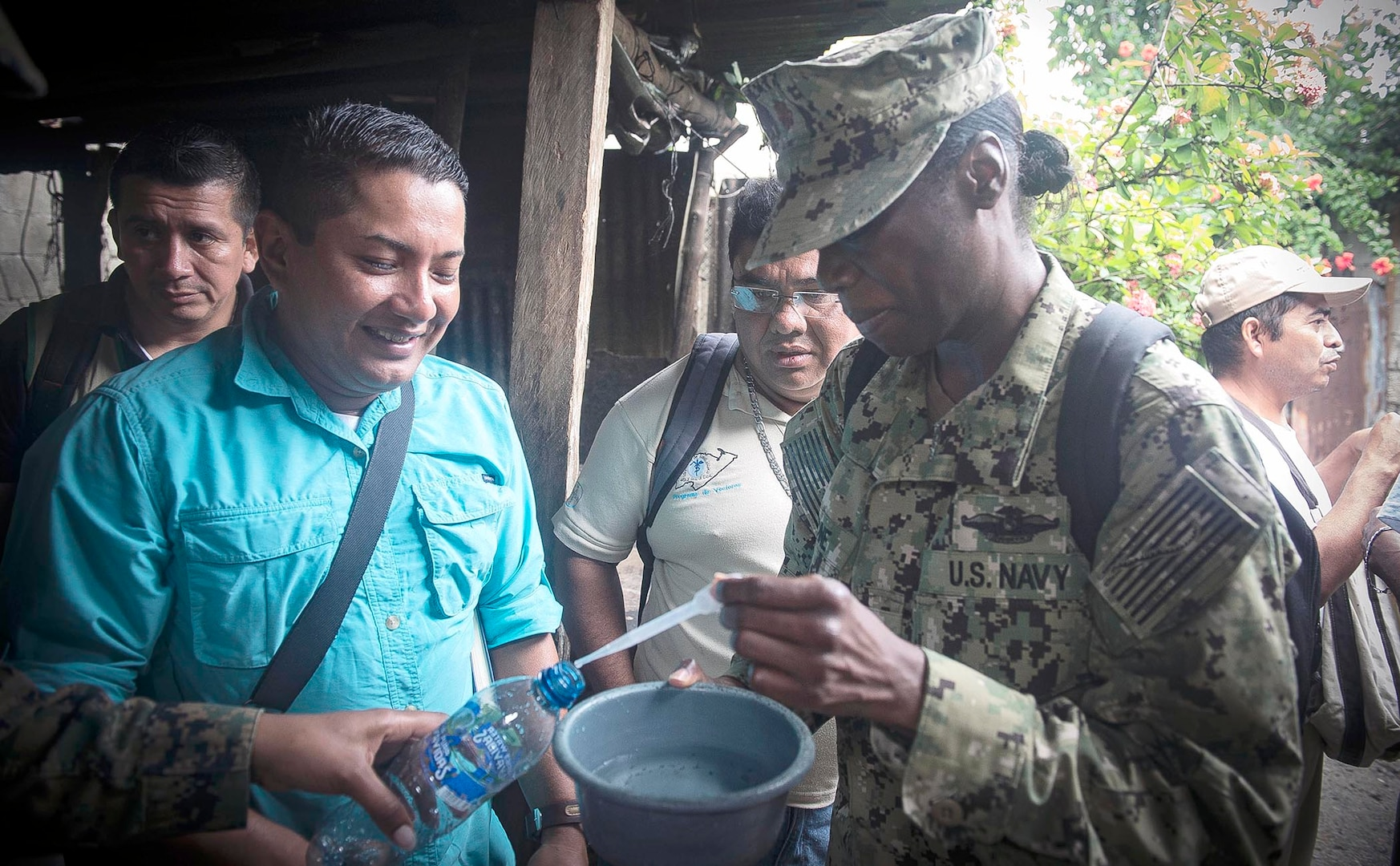 Lt. Cmdr. Jinaki Gourdine (right), assigned to Navy Environmental and Preventive Medicine Unit, or NEPMU, 2, from Norfolk, Va., takes a sample of mosquito-larva contaminated rainwater in the Barrios El Rastro neighborhood of Puerto Barrios, Guatemala, during Continuing Promise 2017, or CP-17, Feb. 10. CP-17 is a U.S. Southern Command-sponsored and U.S. Naval Forces Southern Command/U.S. 4th Fleet-conducted deployment to conduct civil-military operations including humanitarian assistance, training engagements, medical, dental, and veterinary support in an effort to show U.S. support and commitment to Central and South America.