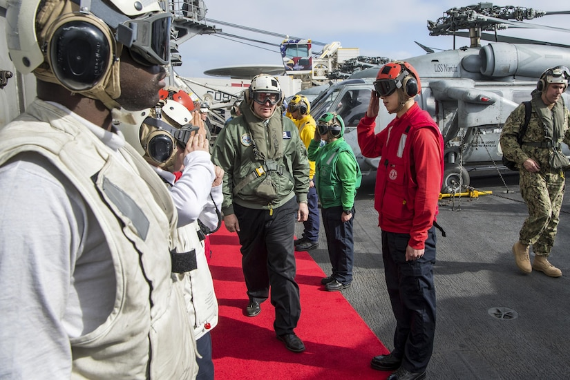 Deputy Defense Secretary Bob Work arrives on board the aircraft carrier USS Nimitz to meet with officers and crew off the coast of San Diego, April 4, 2017. DoD photo by Air Force Staff Sgt. Jette Carr
