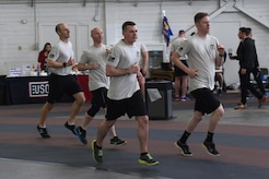 Members of the 3rd Air Support Operations Squadron participate in the annual 24-hour run challenge in Hangar 5 at Joint Base Elmendorf-Richardson, Alaska, March 30, 2017. During the challenge, at least one tactical air control party member ran at any point during the 24 hours. The TACP Airmen also passed a baton listing the names of fallen TACP Airmen to ensure those who made the ultimate sacrifice are never forgotten.