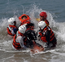 First responders from the Mexican states of Jalisco and Michoacán practice bringing a drowning victim to shore using a rescue sled donated by U.S. Northern Command in Puerto Vallarta, Mexico, March 22, 2017. As part of Northern Command's humanitarian assistance mission, members of the U.S. Public Health Service provided water search and rescue training to Mexican first responders. Air Force photo by 1st Lt. Lauren Hill
