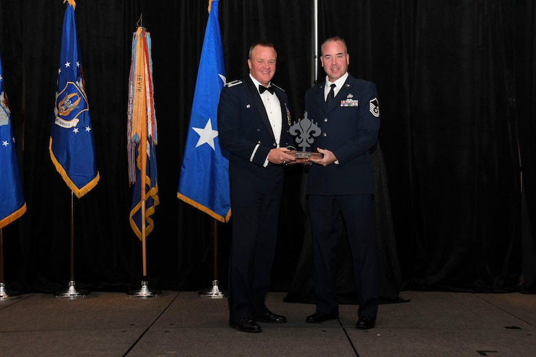 Col. Bruce R. Cox, 307th Bomb Wing commander, presents Master Sgt. Stephen Sorge, 307th Maintenance Squadron, the 307th Bomb Wing's Senior Non-Commissioned Officer of the Year award for 2016. The award was presented during the 307th Bomb Wing's 75th Anniversary and Awards Gala at the Shreveport Convention Center April 1, 2017. (U.S. Air Force photo by Staff Sgt. Callie Ware/Released)