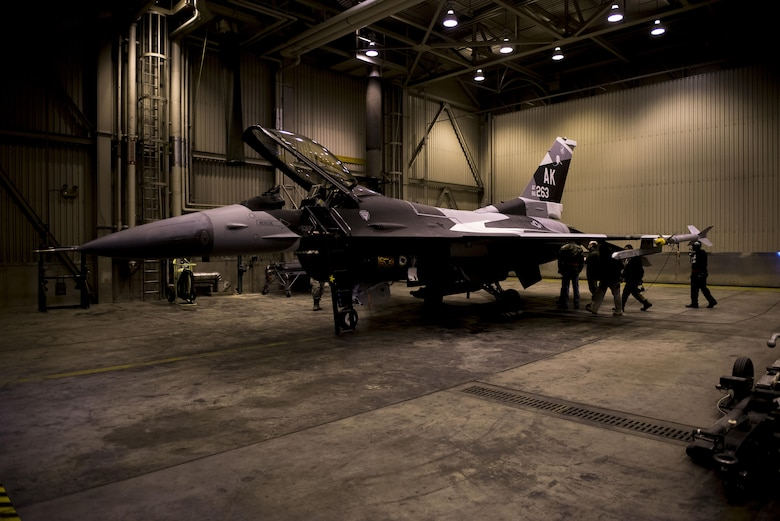 "A U.S. Air Force F-16 Fighting Falcon aircraft sits in a hangar April 4, 2017, at Eielson Air Force Base, Alaska. The F-16 recently received a new paint scheme called ""Splinter,"" which is being adopted as the standard pattern for the 18th Aggressor Squadron's aircraft. (U.S. Air Force photo by Airman Eric M. Fisher)"
