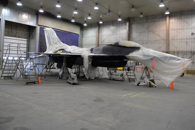 "A U.S. Air Force F-16 Fighting Falcon aircraft sits in a hangar April 4, 2017, at Eielson Air Force Base, Alaska. The F-16 is being painted with the new ""Splinter"" paint scheme by the 354th Maintenance Squadron's structural maintenance repair section.  (U.S. Air Force photo by Airman Eric M. Fisher)"