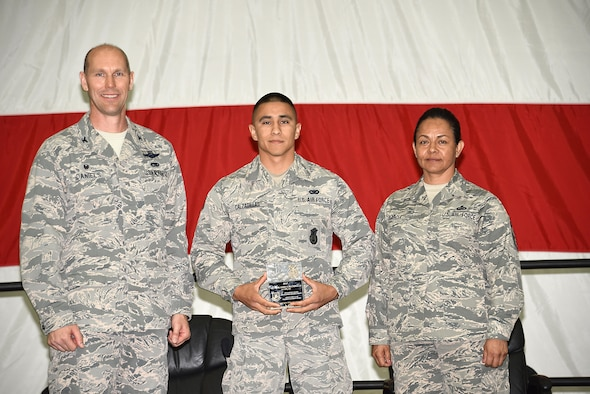 The Airman First Class Elizabeth N. Jacobson Award recipient, Staff Sgt. Orlando Calzadillas, 161st Security Forces Squadron, was recognized at the 161st Air Refueling Wing annual awards ceremony April 2, 2017, Goldwater Air National Guard Base. Col. Troy Daniels, 161st Air Refueling Wing commander and Chief Master Sgt. Martha Garcia, 161st Air Refueling Wing command chief presented. Calzadillas with the award. (U. S. Air National Guard photo by Staff Sgt. Wesley Parrell)
