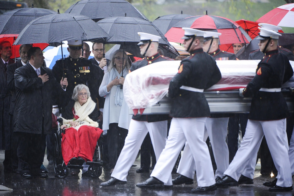 Marines carry the casket of Sen. John Glenn, a former astronaut, in the rain.