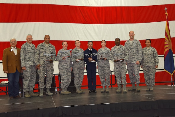 The Outstanding Airmen of the Year were recognized at the 161st Air Refueling Wing annual awards ceremony April 2, 2017, at Goldwater Air National Guard Base. From left to right: retired Chief Master Sgt. Glenn Klassen, Phoenix Air National Guard Patriots, Maj. Gen. Edward Maxwell, Arizona Air National Guard commander, Airman 1st Class Jonathan Sheaffer, Airman of the Year recipient, Master Sgt. Deanna Meyer, Senior Non-Commissioned Officer of the Year recipient, Senior Master Sgt. Rachel Landegent, First Sgt. of the year recipient, Master Sgt. Warren Edwards, Outstanding Honor Guard of the year recipient, Tech. Sgt. Aindrea Tait, Command Chief Master Sgt. Award recipient, 2nd Lt. Tinashe Machona, Maj. Gen. Donald L. Owens Junior Officer of the Year award recipient, Col. Troy Daniels, 161st Air Refueling Wing commander and Chief Master Sgt. Martha Garcia, 161st Air Refueling Wing command chief. (U. S. Air National Guard photo by Staff Sgt. Wesley Parrell)