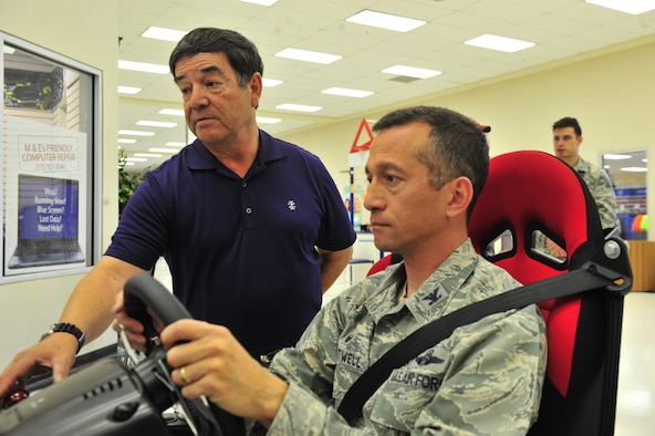 Col. Houston Cantwell, 49th Wing commander, tries out a safe driving simulator with Dan Salinas, a 49th Wing occupational safety technician, during a Distracted Driving Campaign at Holloman Air Force Base, N.M. on April 5, 2017. The simulator is a part of Distracted Driver Awareness Month, a Holloman initiative which promotes safe driving around base. (U.S. Air Force photo by Staff Sgt. Warren Spearman)