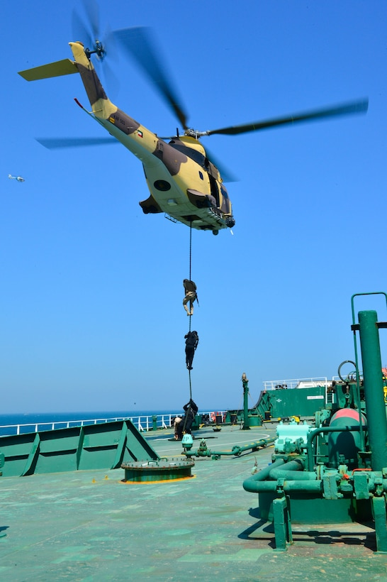 KUWAIT - Gulf Cooperation Council special operations forces execute a fast rope exercise aboard the Kuwait oil tanker the Hadiya, April 3, in Kuwait territorial waters as part of a simulated recovery mission during exercise Eagle Resolve 2017. (U.S. Army Photo by Master Sgt. Timothy Lawn)
