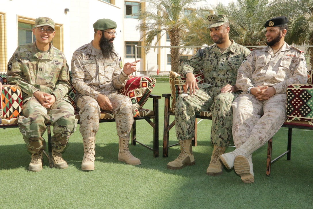 From left to right: U.S. Army Capt. Joon Lim a chaplain with 3rd Brigade Combat Team, 1st Cavalry Division out of Camp Buehring, Kuwait; Col. AL Harbi Eisa H. the chief of religious affairs for the Kingdom of Saudi Arabia; Haneef Mubarak, a U.S. Navy chaplain with Naval Support Activity Bahrain; and Lt. Col. Rabaih H.R. Al-Wutaib, head of Islamic and Social Service Branch out of Kuwait. Chaplains sit and discuss events during exercise Eagle Resolve 2017 at the Mubarak al-Abdullah Joint Command and Staff College March 27. Military-to-military en-gagements like exercise Eagle Resolve demonstrate the value of working in un-familiar environments and organizational interoperability. (U.S. Army Photo by Sgt. Marco Gutierrez)