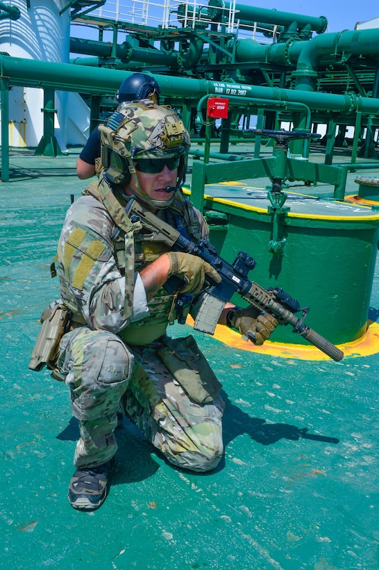 KUWAIT - A U.S. special force operations service member sets a perimeter on the Kuwait oil tanker Hadiyah as part of a simulated maritime interdiction operation during Exercise Eagle Resolve, April 3, in Kuwait territorial waters. (U.S. Army Photo by Master Sgt. Timothy Lawn)