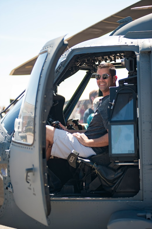 A participant smiles inside the pilot seat of an HH-60G Pave Hawk during the Melbourne Air & Space Show April 1, 2017, at Melbourne, Fla. Airmen from the 920th Rescue Wing displayed the helicopter and equipment used to accomplish the combat search-and-rescue mission. The airshow attracted nearly 200,000 participants and showcased both military and civilian aircraft. (U.S. Air Force photo/Staff Sgt. Jared Trimarchi)