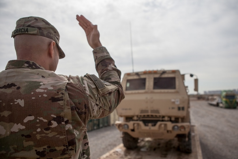 Army Sgt. 1st Class Henry Garcia, deployed in support of Combined Joint Task Force Operation Inherent Resolve and assigned to 583rd Forward Support Company, loads a vehicle for transportation near Irbil, Iraq, March 21, 2017. Army photo by Sgt. Josephine Carlson