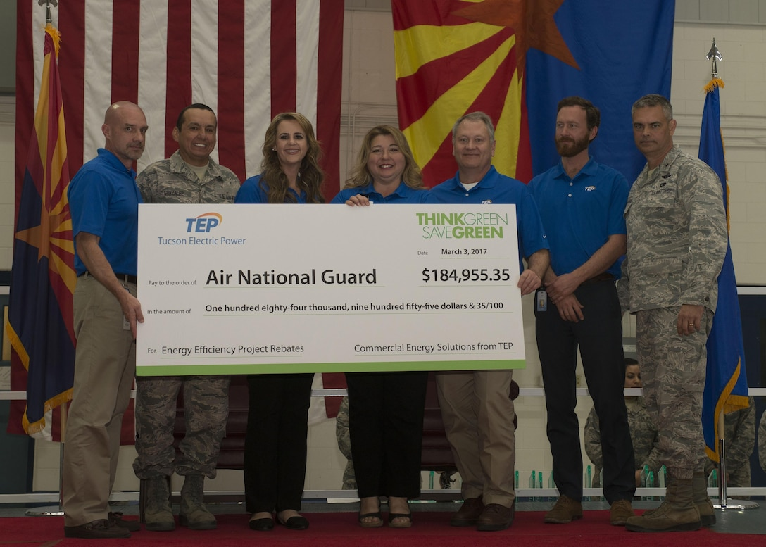The 162nd Wing of the Arizona Air National Guard recognized its annual award winners from 2016 in a ceremony at the Tucson International Airport April 2. During the ceremony the wing's energy efficiency partners from Tucson Electric Power presented Brig. Gen. Andrew MacDonald with a check in recognition of two cost saving energy projects completed during 2016. (U.S.Air National Guard photo by Staff Sgt. Gregory Ferreira)