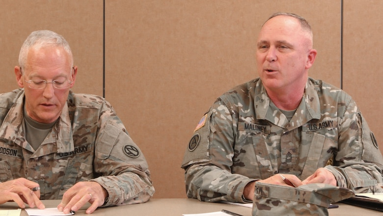 Lt. Col. Gary Goodson (left) from the 824th Quartermaster Company out of Fayetteville, N.C., work together with Master Sgt. Justin Maloney (right) from the 89th Sustainment Brigade out of Kansas City, Mo., as part of the Defense Support of Civil Authorities held in Belton, Mo., on April 2, 2017. (U.S. Army Reserve photo by Spc. Christopher A. Hernandez, 345th Public Affairs Detachment)