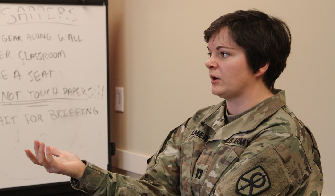 Capt. Kassondra Palmer, commander of the 443rd Transportation Company out of Elkhorn, Neb., gives a briefing during an emergency response scenario as part of the Defense Support of Civil Authorities workshop held in Belton, Mo., on April 2, 2017. (U.S. Army Reserve photo by Spc. Christopher A. Hernandez, 345th Public Affairs Detachment)
