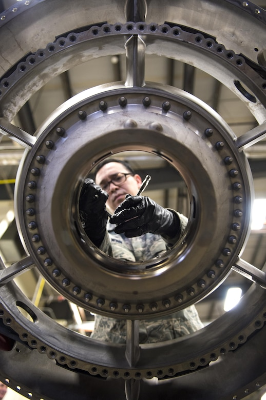 Staff Sgt. James Winn, a 113th Maintenance Squadron aerospace propulsion technician, performs phase maintenance on the fan frame of an F-16 Fighting Falcon engine at Joint Base Andrews, Md., March 27, 2017. The F-16 must go through different inspections to ensure the quality and safety of the aircraft for mission readiness. (U.S. Air Force photo/Airman 1st Class Gabrielle Spalding)