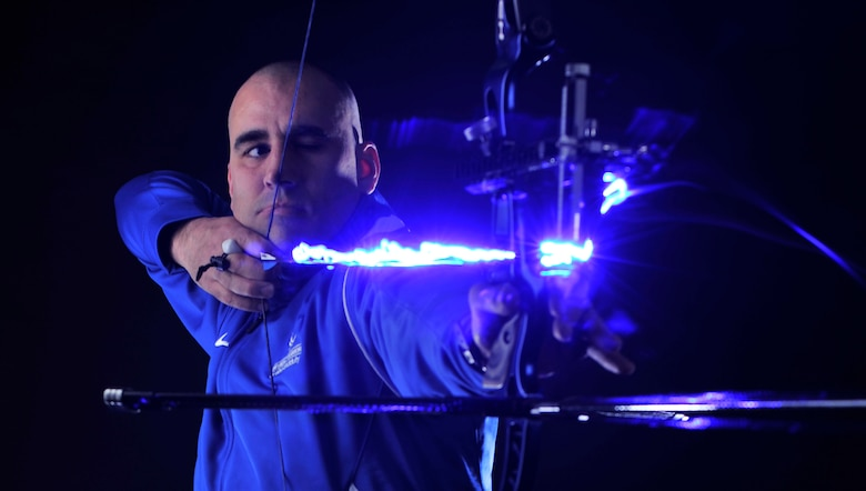 Tech. Sgt. Michael Christiansen, a 100th Security Forces Squadron assistant flight chief, draws back a bow and arrow March 28, 2017, at RAF Mildenhall, England. Christiansen was selected to represent U.S. Air Forces in Europe at the 2017 Department of Defense Warrior Games in Chicago where he will compete in the rifle, pistol, recurve archery and sitting volleyball events. (U.S. Air Force photo/Staff Sgt. Micaiah Anthony)