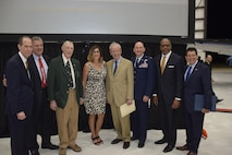 Honorees, from left to right, Wayne Fagan, Chair Honoree Selection Committee, San Antonio Aviation and Aerospace Hall of Fame;  Retired Air Force Col. William Ercoline, who excepted the award on behalf of Col. William Charles Ocker; Retired Air Force Col. W.R. Stewart, who excepted the award for Col. Carl Joseph Crane; Retired, Air Force Lt. Col. E. Olga Custodio, first female Hispanic U.S. military pilot; former San Antonio Mayor, Phil Hardberger; Col. Thomas K. Smith, Jr., 433rd Airlift Wing commander; Dr. Bernard A. Harris, Jr., former NASA astronaut;  and Richard Perez, the President and CEO of the San Antonio Chamber of Commerce pose for a photo after the San Antonio Aviation and Aerospace Hall of Fame awards dinner, March 30, 2017 at the GDC Technics Hanger, Port San Antonio (formerly Kelly Air Force Base), Texas. (U.S. Air Force photo by Minnie Jones)
