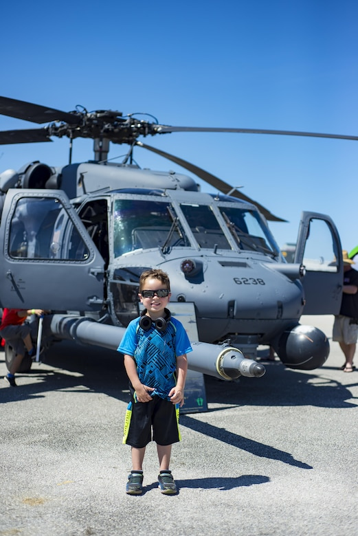 A young boy stands in front of an HH-60G Pave Hawk during the Melbourne Air & Space Show April 1, 2017, at Melbourne, Fla. Airmen from the 920th Rescue Wing displayed the helicopter and equipment used to accomplish the combat search-and-rescue mission. The airshow attracted nearly 200,000 participants and showcased both military and civilian aircraft. (U.S. Air Force photo/Staff Sgt. Jared Trimarchi)