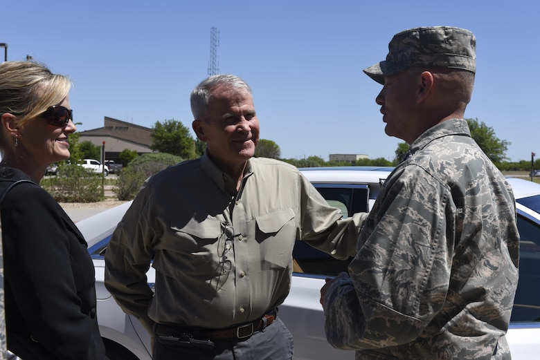 U.S. Marine Corps Lt. Col. (Retired) Oliver North, speaks to U.S. Air Force Col. Michael Downs, 17th Training Wing Commander, at Goodfellow Air Force Base, Texas, April 5, 2017. North visited Goodfellow to see student fire training. (U.S. Air Force photo by Airman 1st Class Chase Sousa/Released)