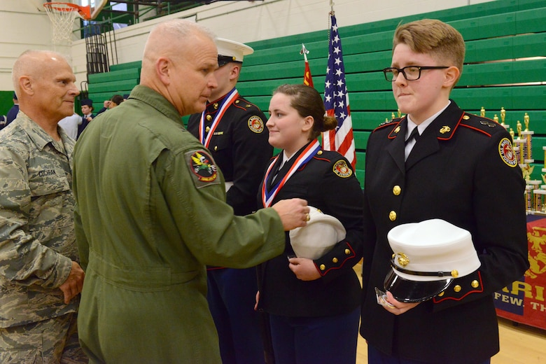 Brig. Gen. Drew Dehaes and Chief MSgt. Timothy Cochran award and congratulate the winners of the knockout competition at the JROTC competition at North High School, Des Moines, Iowa on April 1, 2017. The knockout competition tests the cadet's ability to respond quickly and precisely to drill commands. (U.S. Air National Guard photo by Airman Katelyn Sprott)