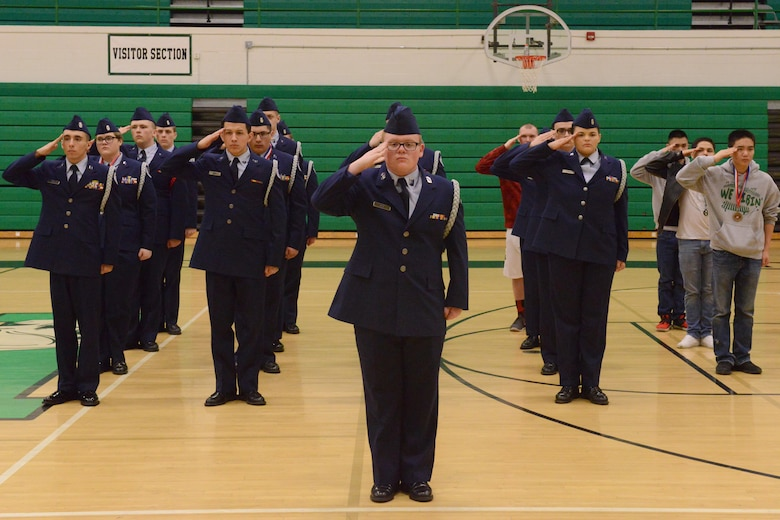 The Sioux City JROTC salutes the winners at the JROTC competition at North High School, Des Moines, Iowa on April 1, 2017. The Davenport JROTC took first and Sioux City took second. (U.S. Air National Guard photo by Airman Katelyn Sprott)
