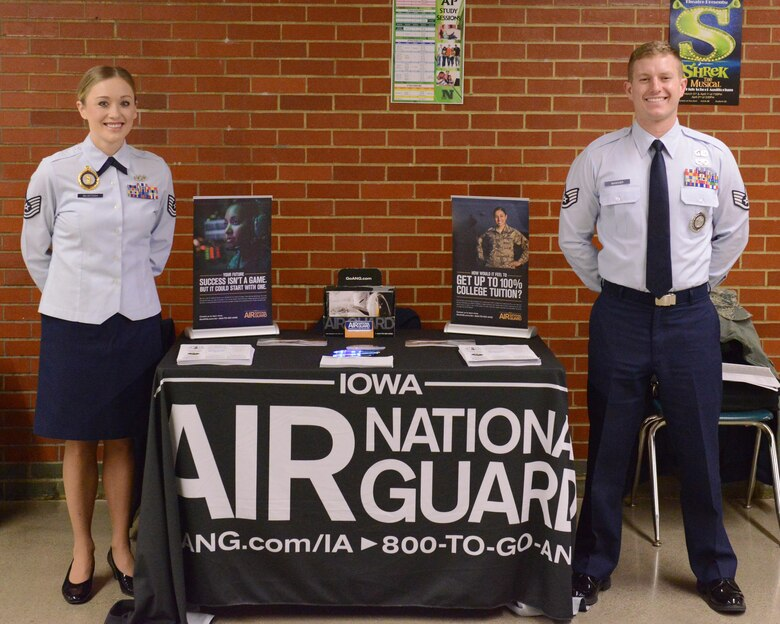 Tech. Sgt. Sabrina Mcintosh and Staff Sgt. Austin Wascher, pose for a photo at the 132nd Wing's recruitment table at the JROTC competition at North High School, Des Moines, Iowa on April 1, 2017. This was the first time that an Air Force recruiting team had attended the competition. (U.S. Air National Guard photo by Airman Katelyn Sprott)