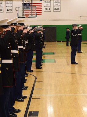 North High, Ottumwa, Davenport and Sioux City JROTC teams salute the flag during the National Anthem at the beginning of the JROTC competition at North High School, Des Moines, Iowa on April 1, 2017. This year there were only four teams due to schedule conflicts, next year there is projected to be 11. (U.S. Air National Guard photo by Airman Katelyn Sprott)