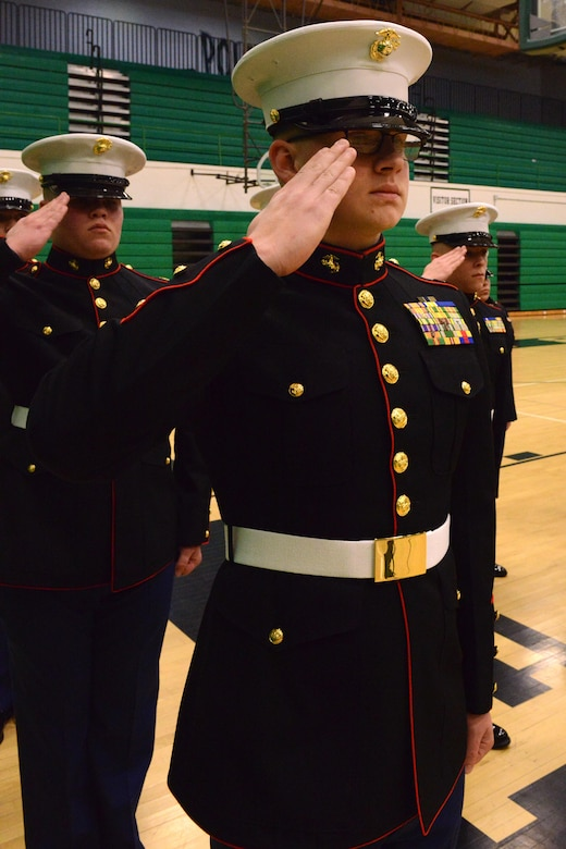 Members of the Davenport JROTC teams salute the flag during the National Anthem at the beginning of the JROTC competition at North High School, Des Moines, Iowa on April 1, 2017. Davenport took overall first place due to their drill and uniform sharpness. (U.S. Air National Guard photo by Airman Katelyn Sprott)